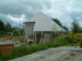Findhorn, house with a conical spiral roof, must go back and see it finished